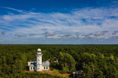 White Uzhava lighthouse. Sunny summer day. Cloudy sky. Banco de Imagens - 129015260