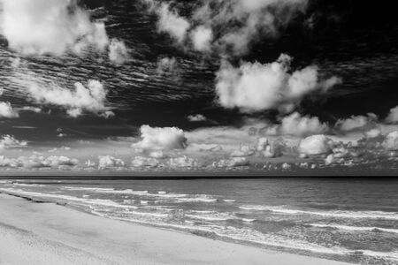 Beautiful view of the sea and the sand beach. Cloudy sky. Banco de Imagens - 129015296