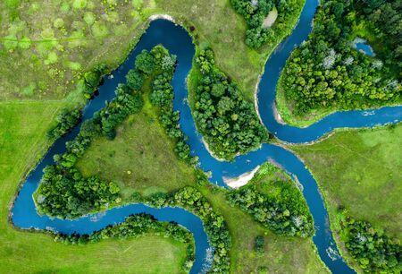 Top view of the beautiful landscape. Green field. Meandering river.