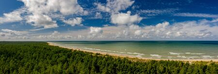 View from above on the sea and forest. Empty seaside.