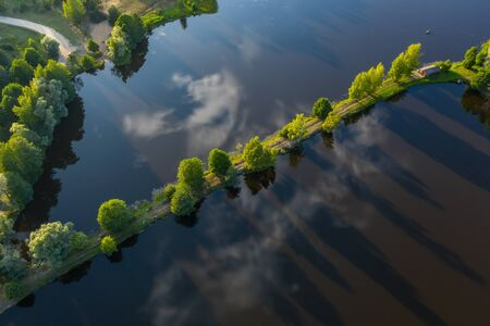 View from above. Green forest. Road through the lake. Banco de Imagens
