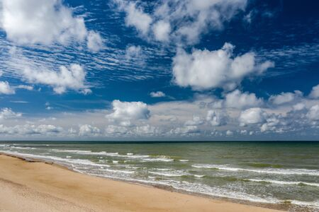 Beautiful view of the sea and the sand beach. Cloudy sky. Banco de Imagens - 129015455