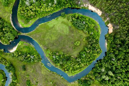 Top view of the beautiful landscape. Green field. Meandering river. Banco de Imagens - 129015456