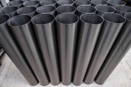 Welded seam on stainless steel ventlation pipes. Metal industry. Close-up.