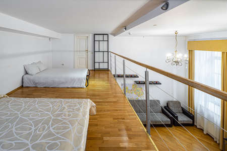 Two beds on the second floor in private house. Modern interior in light tones. White walls. Banco de Imagens