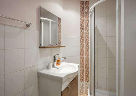 Small bathroom. Modern interior. White tile. Tile floor. Stock fotó
