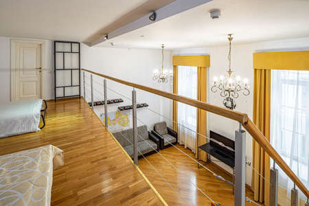 Modern interior of private house. View of living room from the second floor. Standard-Bild