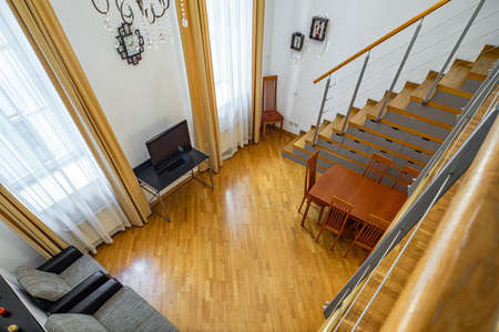 View of living room from the second floor. Private house. Modern interior. Staircase.