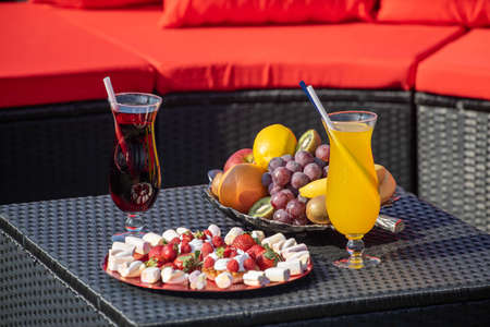 Romantic composition. Couple of drinks. Fruits and delicious desserts. Close-up. Banco de Imagens