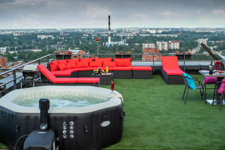 Outdoor   relax zone on the rooftop terrace in modern living complex.