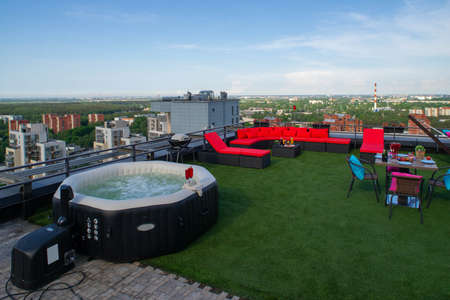 Outdoor  relax zone on the rooftop terrace in modern living complex. Sunny day.
