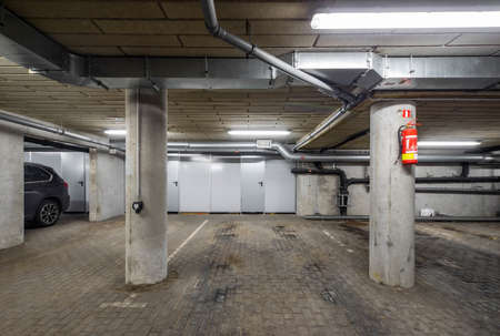 Empty underground parking. Concrete piles.