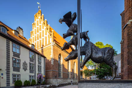 Monument to Bremen musicians and St. John's Church in Old town of Riga.