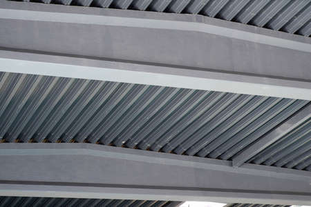 Metal roof inside the hangar. Large room with a tin roof. Metall constructions.