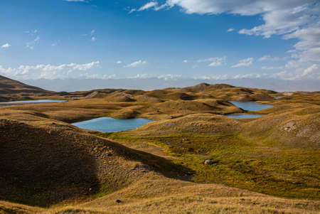 Kyrgyz nature. Lakes between hills. Scenic landscape. Banco de Imagens