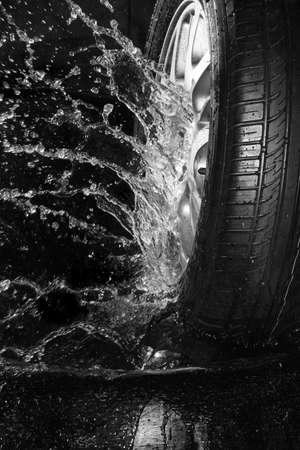 white wash: New summer tire with water spray Stock Photo