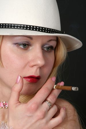 Lady with white hat smoking a cigarette Stock Photo - 3047654