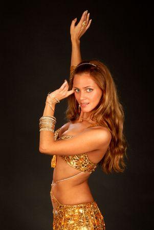 beautiful long hair blonde woman in arabic dance costume Stock Photo