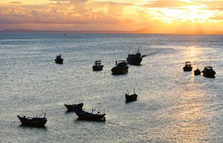 Fisher boats in a sea at sunset time Stock Photo - 3897990