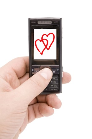 Mobile phone in man hand whith two hearts on display Stock Photo - 4142764