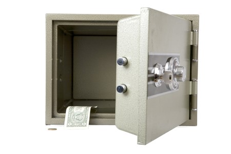 Banks safe with open door almost without money photo