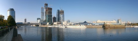 Panorama of business city on Moscow river at sunny autumn day