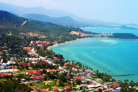 high view of tropical island coastline with homes and trees Stock Photo - 4450162