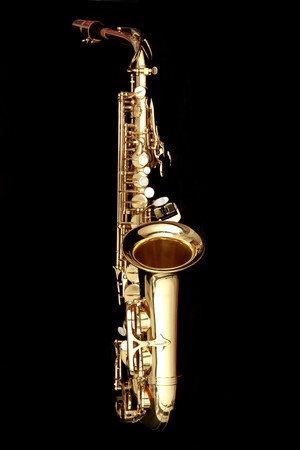 alto: close up gold alto saxophone on black background