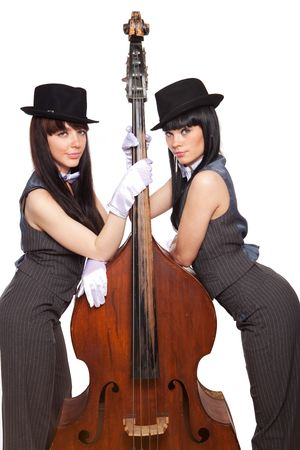 Two young beautiful brunettes with old contrabass photo