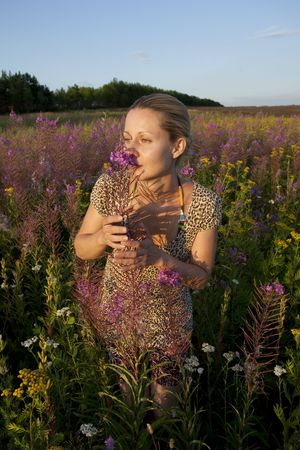 young blonde woman on summer meadow at sunset time Stock Photo - 5314655