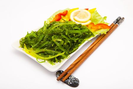 plate of traditional japanese salad  and chopstics