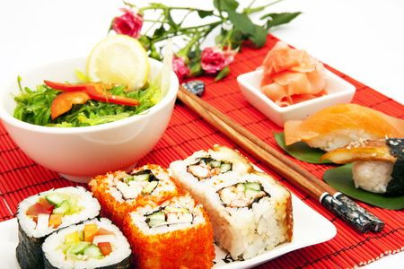 big set of traditional japanese food with chopsticks and flowers