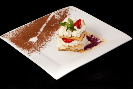sweet dessert with fresh strawberry on white plate
