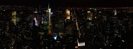 Panoramic view of night city with many skyscrapers