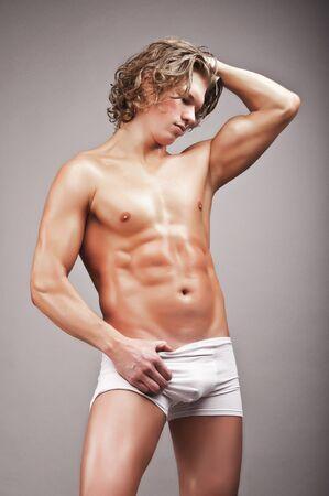 Portrait of mid in underwear. Studio shot