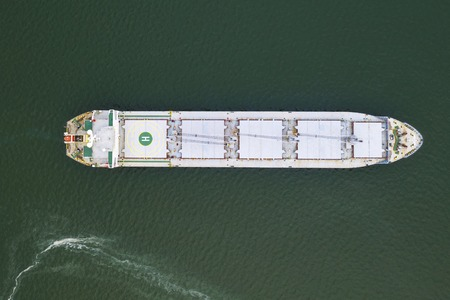 Aerial top view cargo ship in import export business logistic and transportation of international by ship cargo ship in the open sea, with copy space Standard-Bild - 124854708