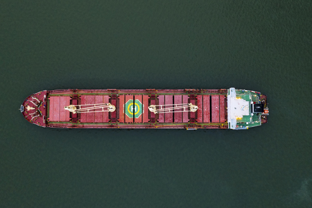 Aerial top view cargo ship in import export business logistic and transportation of international by ship cargo ship in the open sea, with copy space Standard-Bild - 124854709