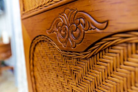 element of the back of a wooden antique chair made of dark wood close-up..