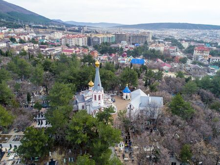 The Orthodox Church in the city of Gelendzhik is located in the old cemetery. The view from the height of bird flight. In the background panorama of the city