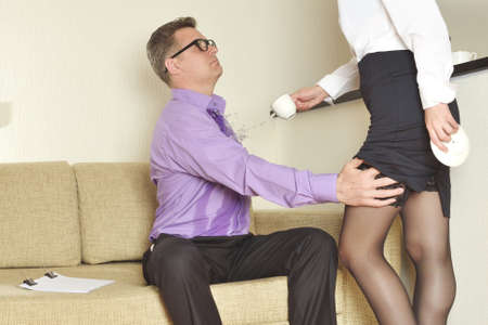 harassment: sexual harassment at work Stock Photo