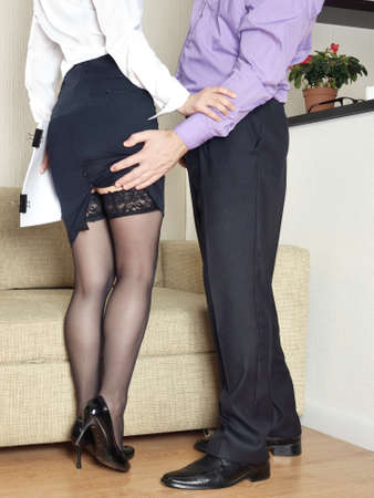 adult sexual: sexual harassment at work Stock Photo