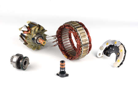 alternator: Generator parts on a white background Stock Photo