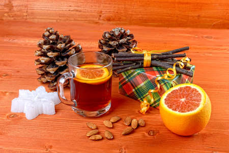 Warming tea with orange Stock Photo