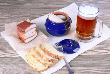 weisswurst: Beer and Bavarian sausages on a wooden background