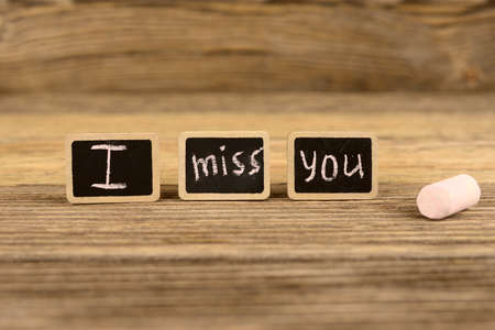 i miss you: Words and symbols I miss you on the wooden background Stock Photo
