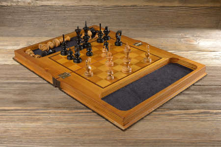 Chess boards on a wooden background