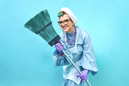 Cleaning Lady smile Fun. Elderly funny housewife fooling around with a broom. Full body isolated