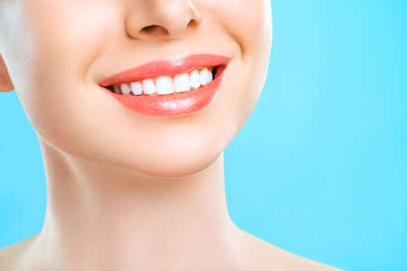 Perfect healthy teeth smile of a young woman. Teeth whitening. Dental clinic patient. Stomatology, dentistry concept.