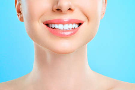 Perfect healthy teeth smile of a young woman. Teeth whitening. Dental clinic patient. Stomatology concept. 版權商用圖片