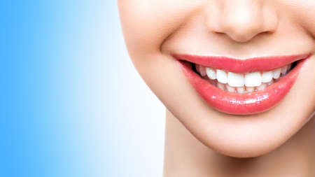 Beautiful young woman smile. Dental health background. Imagens